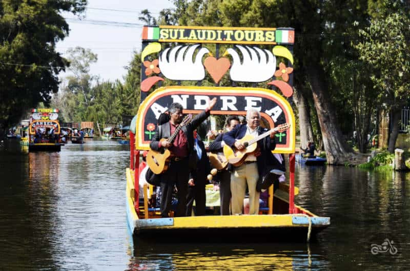 A mariachi band performs on a boat at Xochimilco.