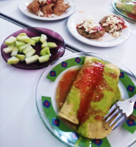 Typical food of a Mexican cantina - botanas or snacks of enchiladas and cucumber.