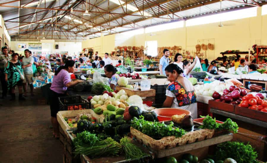 People buying vegetables at the Mercado in Valladolid Yucatan.