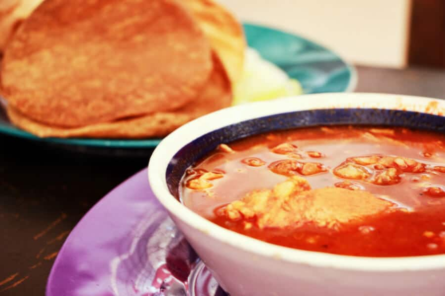 A close up of Pozole with tortillas at the food court in Valladolid.