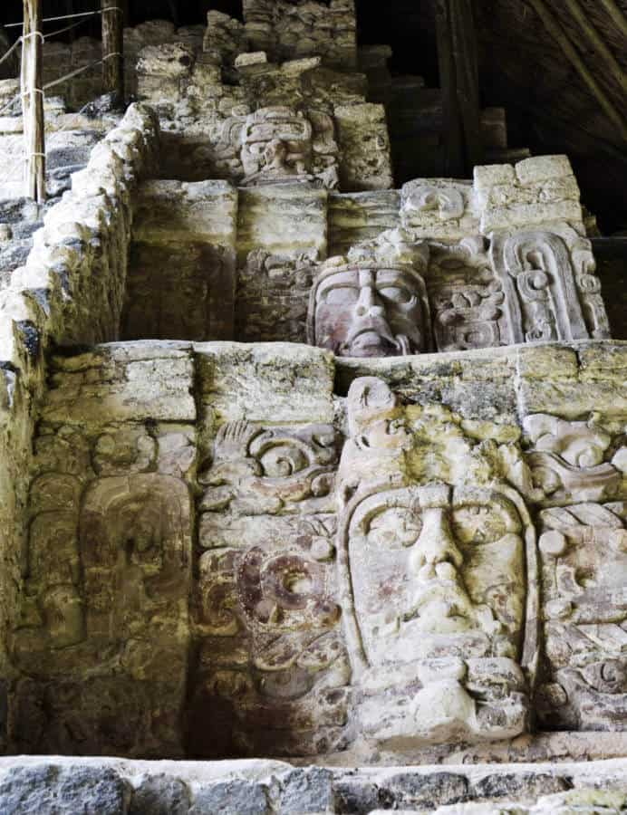 Stone carved masks at Kohunlich Mayan Ruins in the southern Yucatan Peninsula.
